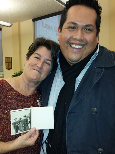 University Archivist and Chair of the Department of Archives and Special Collections, Lori N. Curtis, and her Assistant, Michael Olivarez holding the newly discover photograph