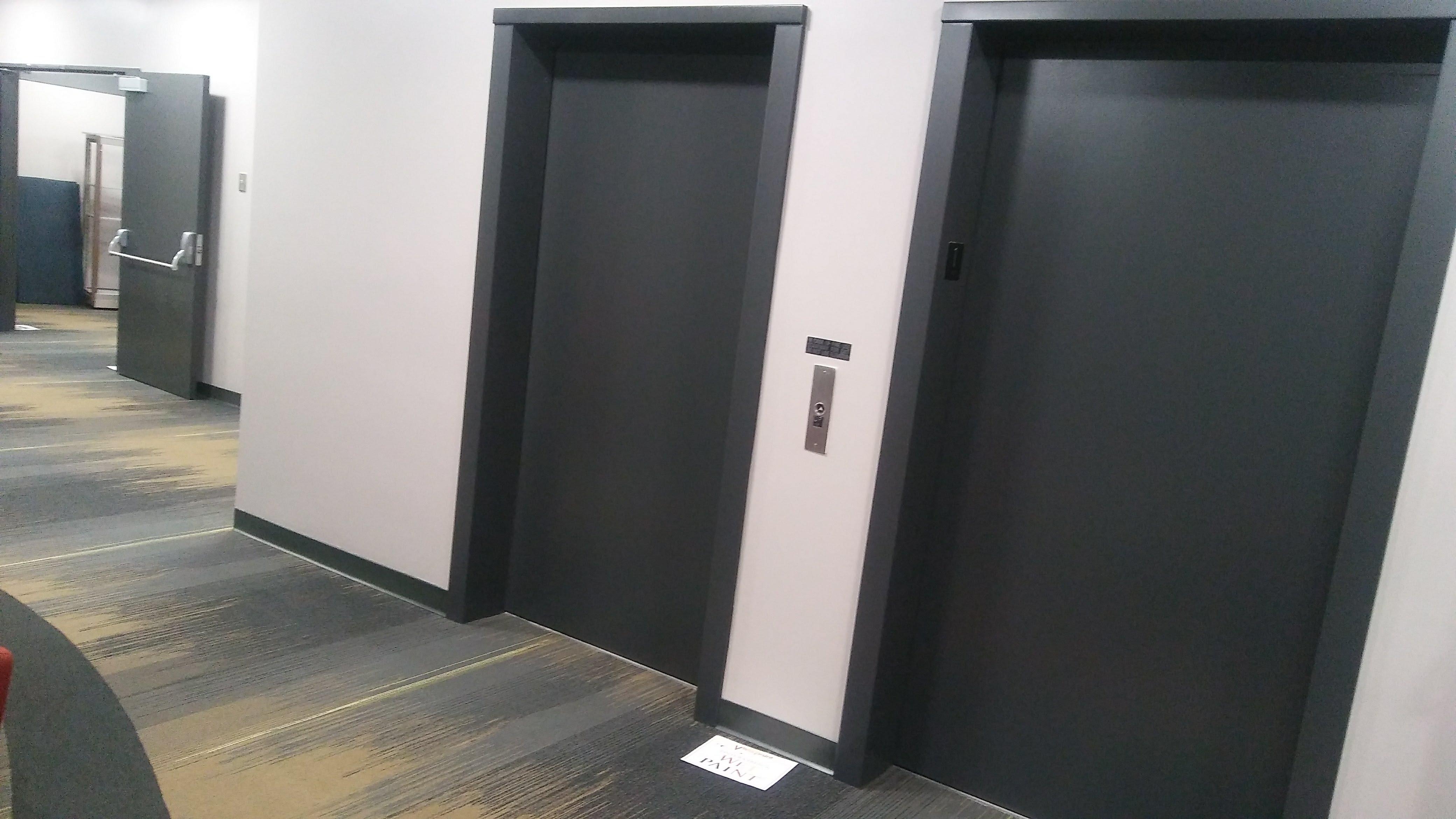 black elevator doors